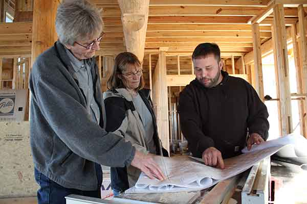 Dale Kidder working with clients on their custom home